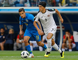 June 22, 2018 - Saint Petersburg, Russia - Philippe Coutinho (L) of Brazil national team and Christian Bolanos of Costa Rica national team vie for the ball during the 2018 FIFA World Cup Russia group E match between Brazil and Costa Rica on June 22, 2018 at Saint Petersburg Stadium in Saint Petersburg, Russia. (Credit Image: © Mike Kireev/NurPhoto via ZUMA Press)