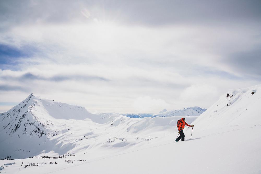 Ali Vagnini explores the alpine terrain above the Meadow Hut, Esplanade Range, British Columbia.
