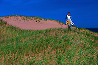"""Young girl portraying """"Anne of Green Gables,"""" dunes near Park Corner, Prince Edward Island, Canada"""