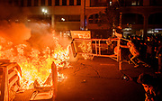 Protesters push a traffic message sign into a fire near 19th Street Bart station in Oakland, Friday, May 29, 2020. Demonstrators gathered Friday night in Oakland to protest the death of Minneapolis man George Floyd.