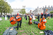 Freelance professional musicians wearing face protective masks and keeping social distance are gathered in Parliament Gardens, outside the Houses of Commons in London, on Tuesday, Oct 6, 2020 - ahead of a two minute silence for the Let Music Live campaign, raising awareness of the need for targeted support for freelance musicians during the coronavirus pandemic and calling on the Government to recognise that freelance musicians are an economic asset.  Musicians in Britain are using their voices and instruments to protest against the government instructions to retrain and lack of support to the industry. (VXP Photo/ Vudi Xhymshiti)