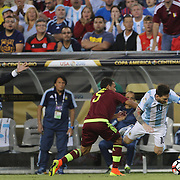 FOXBOROUGH, MASSACHUSETTS - JUNE 18:   Lionel Messi #10 of Argentina is fouled by Arquimedes Figuera #5 of Venezuela during the Argentina Vs Venezuela Quarterfinal match of the Copa America Centenario USA 2016 Tournament at Gillette Stadium on June 18, 2016 in Foxborough, Massachusetts. (Photo by Tim Clayton/Corbis via Getty Images)