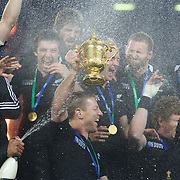 Brad Thorn, New Zealand, is sprayed by team mates as he holds the Rugby World Cup as the team celebrates during the New Zealand V France Final at the IRB Rugby World Cup tournament, Eden Park, Auckland, New Zealand. 23rd October 2011. Photo Tim Clayton...