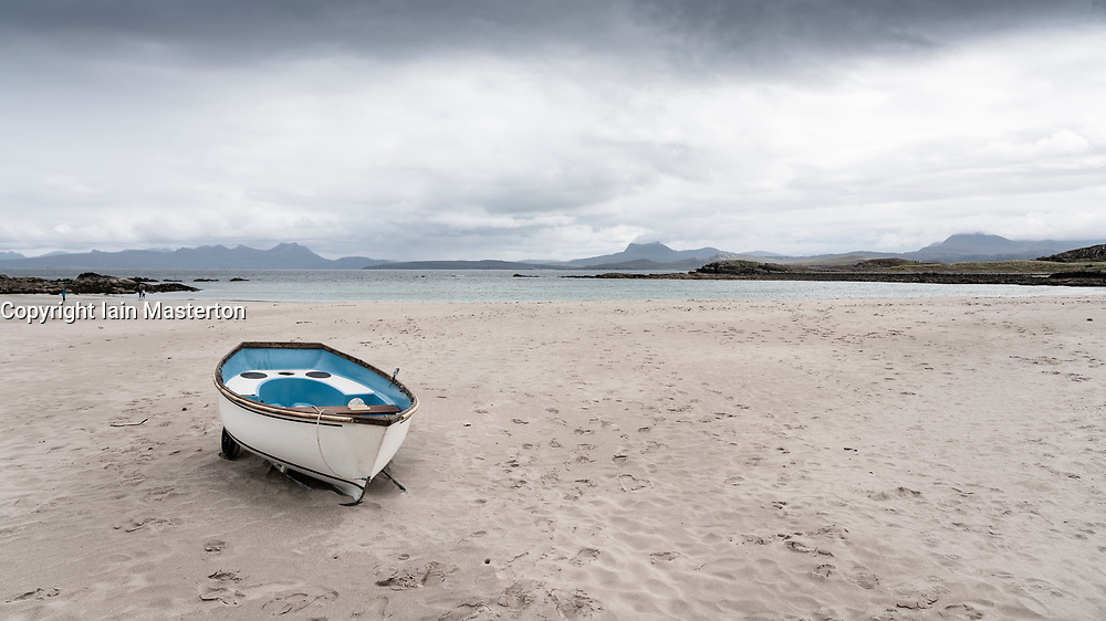 Boat on Mellon Udrigle beach in Ross-shire in Scottish Highlands, UK