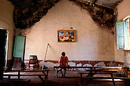 A boy sits in Tambura's Catholic church after the LRA attacked the towns' outskirts.