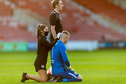 WREXHAM, WALES - Thursday, September 17, 2020: Physio Gemma Bamford treats Connah's Quay Nomads' goalkeeper Lewis Brass for a head injury during the UEFA Europa League Second Qualifying Round match between Connah's Quay Nomads FC and FC Dinamo Tbilisi at the Racecourse Ground. Dinamo Tiblisi won 1-0. (Pic by David Rawcliffe/Propaganda)