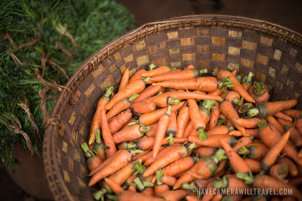 A basket of carrots at the fish and flower market in Mandalay, Myanmar (Burma).