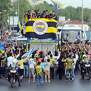 Fenerbahce players celebrate their Turkish Super League championship win as they travel to Sukru Saracoglu stadium for a trophy ceremony in Istanbul May 23, 2011. Fenerbahce clinched their 18th Turkish league title with a 4-3 win over Sivasspor on Sunday, moving ahead of the 17 won by arch-rivals Galatasaray. Photo by TURKPIX