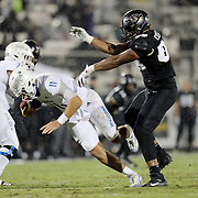 ORLANDO, FL - OCTOBER 03:  Joshua Celiscar #88 of the Central Florida Knights sacks quarterback Zach Smith #11 of the Tulsa Golden Hurricane at Bright House Networks Stadium on October 3, 2020 in Orlando, Florida. (Photo by Alex Menendez/Getty Images) *** Local Caption *** Joshua Celiscar; Zach Smith