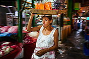 08 JANUARY 2007 - MANAGUA, NICARAGUA:  A refreshment vendor walks through Mercado Oriental, the main market that serves Managua, Nicaragua. The market encompasses dozens of square blocks and is the largest market in Central America.  Photo by Jack Kurtz