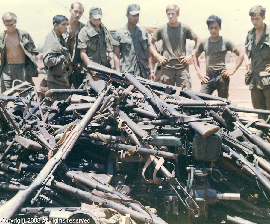 Personnel at Quan Loi landing zone look over and assortment of enemy weapons flown in by helicopter from the Fishhook are of Cambodia. May 5, 1970 in III Corps. Quan Loi was also the home of the B Troop, 1st Squadron, 9th Cavalry, the 11th ACR and other units. The Russian and Chinese arms were part of a cache of weapons captured during the 1970 Cambodian incursion.