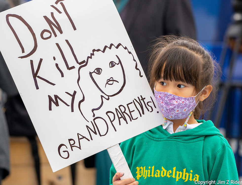 A young Asian American girl has a message for those spreading hate as she participates in a solidarity rally in Chinatown, Philadelphia, PA