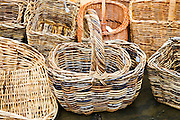 Wicker baskets on sale in Burford in the Cotswolds, Oxfordshire, UK