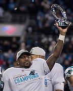 CHARLOTTE, NC - JAN 24:  Linebacker Thomas Davis #58 of the Carolina Panthers holds the NFC championship trophy after the NFC Championship game against the Arizona Cardinals at Bank of America Stadium on January 24, 2016 in Charlotte, North Carolina.