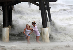 October 8, 2016 - Cocoa Beach, Florida, U.S. - DOUGLAS R. CLIFFORD   |   Times.Kaleigh Black, 14, left, and Amber Olsen, 12, run for cover as a squall with rain and wind pelt them while they explore the Cocoa Beach Pier on Friday (10/7/16) after hurricane Matthew passed to the east on Florida's east coast. (Credit Image: © Douglas R. Clifford/Tampa Bay Times via ZUMA Wire)