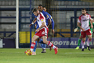 Stevanage attacker Ben Kennedy (10) taking on AFC Wimbledon midfielder Liam Trotter (14) during the EFL Trophy group stage match between AFC Wimbledon and Stevenage at the Cherry Red Records Stadium, Kingston, England on 6 November 2018.