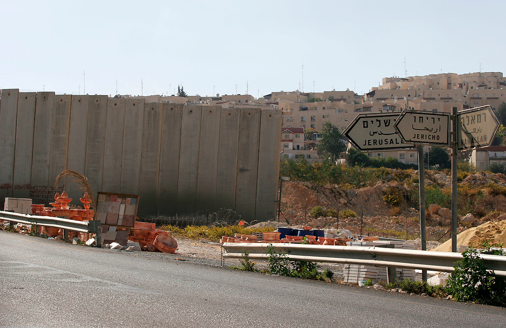 The east Jerusalem neighborhood of Pisgat Zeev is seen behind a section of Israel's separation barrier along route 437, near the Hizme checkpoint, on October 27, 2007.