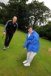Woman with learning disabilities playing pitch and putt; as part of a Sport Ability Day North Yorkshire, UK