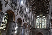 Interior view of the nave in Hereford Cathedral on 7th June 2021 in Hereford, United Kingdom. Hereford Cathedral is the cathedral church of the Anglican Diocese of Hereford, England. A place of worship has existed on the site of the present building since the 8th century or earlier. The present building was begun in 1079. Substantial parts of the building date from both the Norman and the Gothic periods.