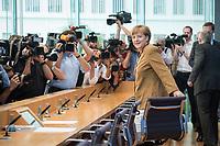 18 JUL 2014, BERLIN/GERMANY:<br /> Angela Merkel, CDU, Bundeskanzlerin, vor Beginn der sog. Sommer-Pressekonferenz der Bundeskanzlerin zu aktuellen Themen der Innen- und Außenpolitik, Bundespressekonferenz<br /> IMAGE: 20140718-01-004<br /> KEYWORDS: Kamera, Camera, Journalist, Journalisten, Fotografen, Kameraleute