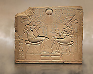 Ancient Egyptian house altar relief sculpture of Akhenaten, Nefrertiti and their three daughters. 18th Dynasty 1345 BC . Neues Museum Berlin AM 14145. .<br /> <br /> If you prefer to buy from our ALAMY PHOTO LIBRARY  Collection visit : https://www.alamy.com/portfolio/paul-williams-funkystock/ancient-egyptian-art-artefacts.html  . Type -   Neues    - into the LOWER SEARCH WITHIN GALLERY box. Refine search by adding background colour, subject etc<br /> <br /> Visit our ANCIENT WORLD PHOTO COLLECTIONS for more photos to download or buy as wall art prints https://funkystock.photoshelter.com/gallery-collection/Ancient-World-Art-Antiquities-Historic-Sites-Pictures-Images-of/C00006u26yqSkDOM