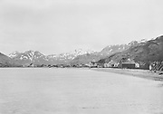 "9707-K234. written on original negative envelope: ""Unalaska from the northwest, looking along shore."" June 22-24, 1917 Alaska"