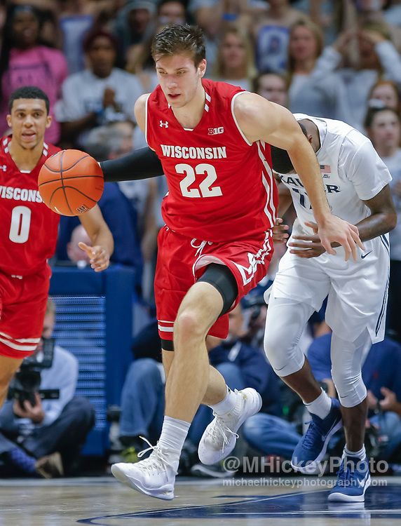 CINCINNATI, OH - NOVEMBER 13: Ethan Happ #22 of the Wisconsin Badgers brings the ball up court during the game against the Xavier Musketeers at Cintas Center on November 13, 2018 in Cincinnati, Ohio. (Photo by Michael Hickey/Getty Images) *** Local Caption *** Ethan Happ