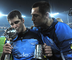 29/05/2010.Morne Steyn kisses the  Vodacom Super 14 trophy after defending it from the Vodacom Stormers at Orlando Stadium in Soweto. Along side him is Pierre Spies.