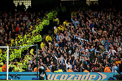 MANCHESTER, ENGLAND - Monday, April 30, 2012: Manchester City supporters celebrate in front of their Manchester United rivals after the 1-0 victory during the Premiership match at the City of Manchester Stadium. (Pic by David Rawcliffe/Propaganda)