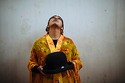 """Sarita, alias """"The Romantic"""", dresses a traditional of Aymara people formed by a embroidered shawl, a pollera (a baggy skirt), and a bombin (a traditional bowler hat), to participate in the wrestling show in El Alto, Bolivia, February 26, 2012. <br /> SPANISH: Sarita """"La Romántica"""" con su manta pollera y sombrero, vestimenta tradicional de Bolivia se prepara para su participación en el espectáculo de lucha libre, en El Alto, Bolivia, el 26 de Febrero de 2012."""