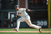 San Francisco Giants shortstop Brandon Crawford (35) attempts to steal second base against the Philadelphia Phillies at AT&T Park in San Francisco, California, on August 20, 2017. (Stan Olszewski/Special to S.F. Examiner)