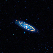 The immense Andromeda galaxy, also known as Messier 31 or simply M31, is captured in full in this new image from NASA's Wide-field Infrared Survey Explorer, or WISE. The mosaic covers an area equivalent to more than 100 full moons, or five degrees across the sky. WISE used all four of its infrared detectors to capture this picture (3.4- and 4.6-micron light is collared blue; 12-micron light is green; and 22-micron light is red). Blue highlights mature stars, while yellow and red show dust heated by new-born, massive stars Andromeda is the closest large galaxy to our Milky Way galaxy, and is located 2.5 million light-years from our sun. It is close enough for telescopes to spy the details of its ringed arms of new stars and hazy blue backbone of older stars. Also seen in the mosaic are two satellite galaxies, known as M32, located just a bit above Andromeda to the left of centre, and the fuzzy blue M110, located below the centre of the great spiral arms. These satellites are the largest of several that are gravitationally bound to Andromeda. The Andromeda galaxy is larger than our Milky Way and contains more stars, but the Milky Way is thought to perhaps have more mass due to its larger proportion of a mysterious substance called dark matter. Both galaxies belong to our so-called Local Group, a collection of more than 50 galaxies, most of which are tiny dwarf systems. In its quest to map the whole sky, WISE will capture the entire Local Group. NASA's Jet Propulsion Laboratory, Pasadena, Calif., manages the Wide-field Infrared Survey Explorer for NASA's Science Mission Directorate, Washington. The mission's principal investigator, Edward Wright, is at UCLA. The mission was competitively selected under NASA's Explorers Program managed by the Goddard Space Flight Centre, Greenbelt, Md. The science instrument was built by the Space Dynamics Laboratory, Logan, Utah, and the spacecraft was built by Ball Aerospace & Technologies Corp., Boulder, Colo. Science operations and