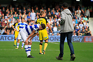 A pitch-invader approaches Queens Park Rangers defender Jack Robinson (18) during the EFL Sky Bet Championship match between Queens Park Rangers and Burton Albion at the Loftus Road Stadium, London, England on 23 September 2017. Photo by Richard Holmes.