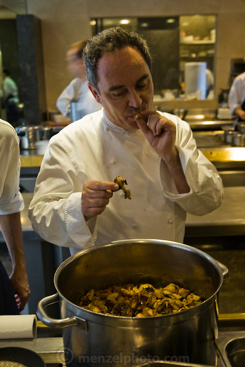 Ferran Adrià, chef of El Bulli restaurant, tastes meat in the kitchen area of the restaurant near Rosas on the Costa Brava in northern Spain.   (Ferran Adria is featured in the book What I Eat: Around the World in 80 Diets.)