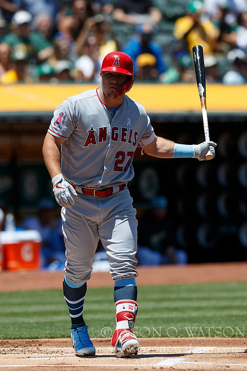 OAKLAND, CA - JUNE 17: Mike Trout #27 of the Los Angeles Angels of Anaheim tosses his bat after he is hit by a pitch from Daniel Mengden (not pictured) of the Oakland Athletics during the first inning at the Oakland Coliseum on June 17, 2018 in Oakland, California. The Oakland Athletics defeated the Los Angeles Angels of Anaheim 6-5 in 11 innings. (Photo by Jason O. Watson/Getty Images) *** Local Caption *** Mike Trout