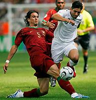 Photo: Glyn Thomas.<br />Portugal v Iran. Group D, FIFA World Cup 2006. 17/06/2006.<br /> Portugal's Fernando Meria (L) and Iran's Vahid Hashemian.