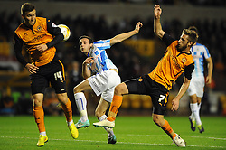 Huddersfield Town's Jack Robinson takes a shot at goal. - Photo mandatory by-line: Dougie Allward/JMP - Mobile: 07966 386802 - 01/10/2014 - SPORT - Football - Wolverhampton - Molineux Stadium - Wolverhampton Wonderers v Huddersfield Town - Sky Bet Championship