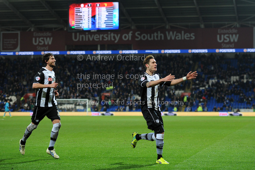 Watford 's Gabriele Angella (r) celebrates after he scores his teams 4th  goal to make it 1-4.  Skybet football league championship match, Cardiff city v Watford at the Cardiff city stadium in Cardiff, South Wales on Sunday 28th December 2014<br /> pic by Andrew Orchard, Andrew Orchard sports photography.