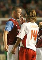 Photo: Mark Stephenson.<br /> Walsall v Aston Villa. Pre Season Friendly. 07/08/2007.Walsall's Carlos Carneiro slaps Villa's Gary Cahill on the face