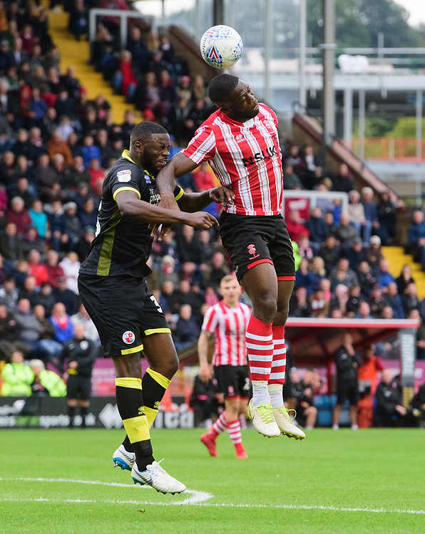 Lincoln City's John Akinde vies for possession with Crawley Town's Bondz Ngala<br /> <br /> Photographer Chris Vaughan/CameraSport<br /> <br /> The EFL Sky Bet League Two - Lincoln City v Crawley Town - Saturday September 8th 2018 - Sincil Bank - Lincoln<br /> <br /> World Copyright © 2018 CameraSport. All rights reserved. 43 Linden Ave. Countesthorpe. Leicester. England. LE8 5PG - Tel: +44 (0) 116 277 4147 - admin@camerasport.com - www.camerasport.com