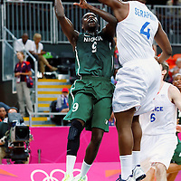 06 August 2012: Nigeria Chamberlain Oguchi is rejected by France Kevin Seraphin during 79-73 Team France victory over Team Nigeria, during the men's basketball preliminary, at the Basketball Arena, in London, Great Britain.