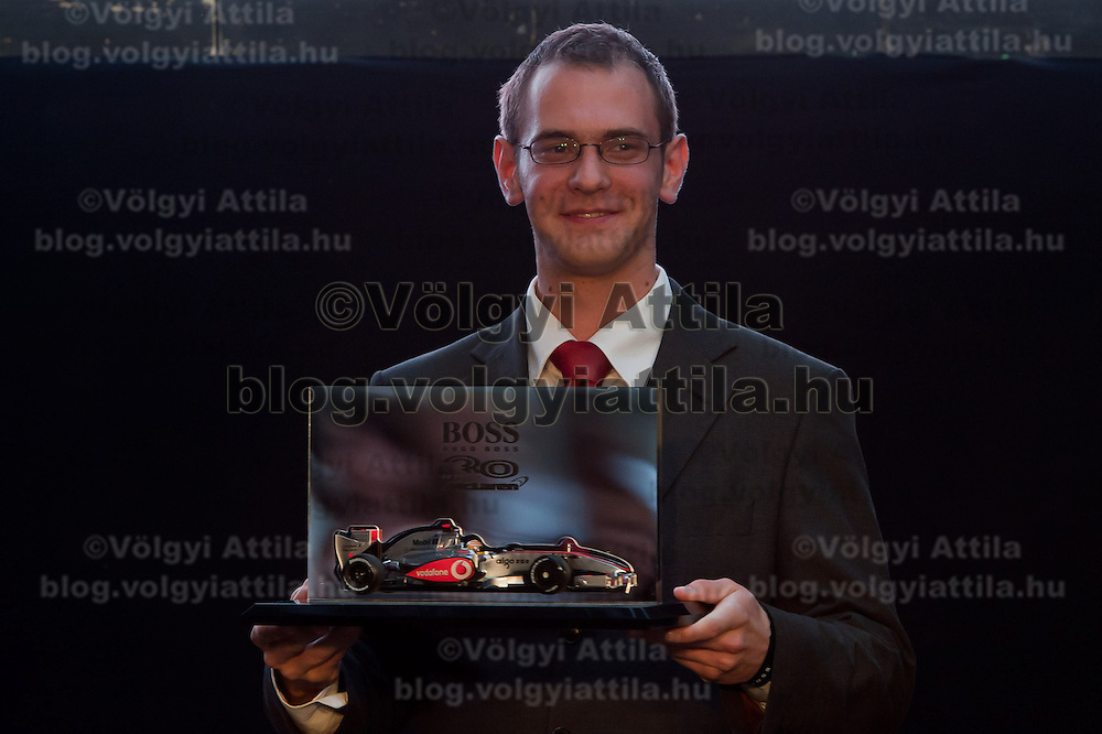 Istvan Kalmar is awarded for his new traditional Hungarian design overall for the McLaren team drivers during the annual Hugo Boss party just prior to the Hungarian F1 Grand Prix in Budapest, Hungary. Thursday, 28. July 2011. ATTILA VOLGYI