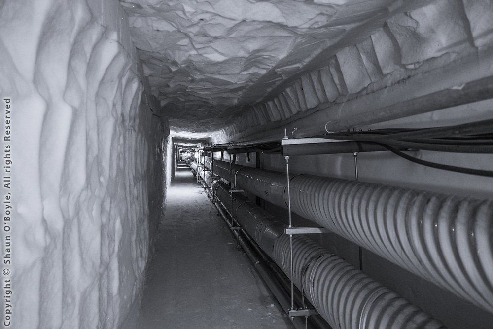 Utility tunnels 60 to 70 feet under the ice, South Pole Station. These tunnels are at a constant temperature of the surrounding ice, -49 C (-57 F).