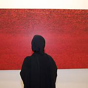 Art Dubai 2009: ASIA, UNITED ARAB EMIRATES, EMIRATE DUBAI, DUBAI 18.03.2009: Art Dubai is the most important art fair in the Middle East. A woman inpecting a piece of art.