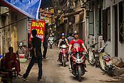 05 APRIL 2012 - HANOI, VIETNAM:   An alley in Hanoi, the capital of Vietnam. The sign advertises Bun, a type of Vietnamese noodle soup.     PHOTO BY JACK KURTZ
