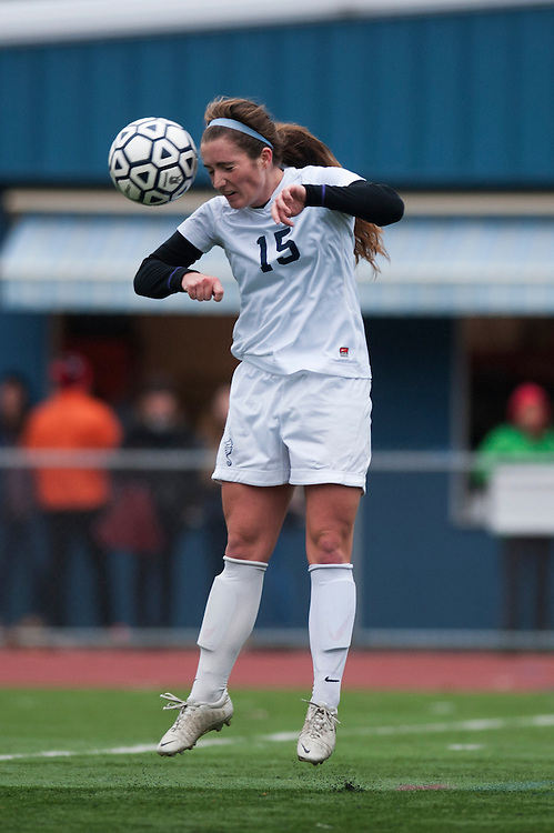 Burlington's Madison Feeney (15) leaps to head the ball during the girls playoff soccer game between the U-32 Raiders and the Burlington Sea Horses at Buck Hard Field on Friday afternoon October 24, 2014 in Burlington, Vermont (BRIAN JENKINS, for the Free Press)