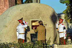 SANTIAGO DE CUBA, Dec. 4, 2016 (Xinhua) -- Image provided by the Cuban News Agency shows Cuban President Raul Castro (C) placing the urn with the ashes of Cuban revolutionary leader Fidel Castro into his tomb, at the Santa Ifigenia Cemetery in the city of Santiago de Cuba, Cuba, on Dec. 4, 2016. The remains of the Cuban revolutionary leader and former President Fidel Castro were buried Sunday morning at the Santa Ifigenia cemetery in Santiago de Cuba. (Xinhua/Marcelino Vazquez/Cuban News Agency) (fnc) (ce) ***MANDATORY CREDIT*** ***NO ARCHIVE-NO SALES*** ***EDITORIAL USE ONLY*** ***BEST QUALITY AVAILABLE* (Credit Image: © [E]Cuban News Agency/Xinhua via ZUMA Wire)