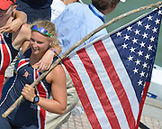 Plovdiv BULGARIA.    Junior Women's Four, Silver  Medalist,  Chase KENDALL,  holds the stars and Stripes flag before the medal ceremony . 2012 FISA Junior and Non Olympic . Rowing Championships, Plovdiv Rowing Course.     10:43:36  Saturday  18/08/2012 [Mandatory Credit Peter Spurrier: Intersport Images]...