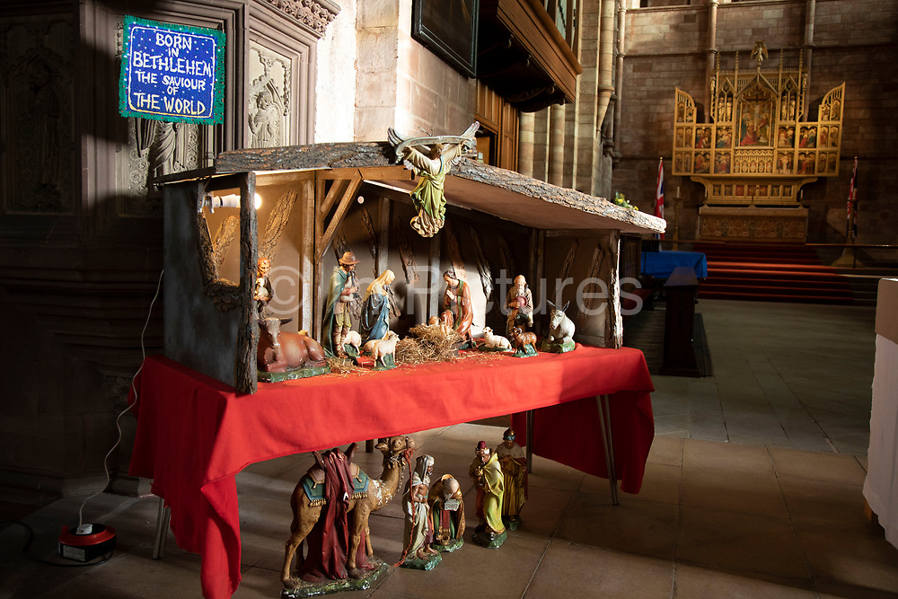 Interior of a Nativity scene, set up in Church of England denomination Shrewsbury Abbey in Shrewsbury, United Kingdom. The Abbey Church of Saint Peter and Saint Paul, Shrewsbury is an ancient foundation in Shrewsbury, the county town of Shropshire, England. The Abbey was founded in 1083 as a Benedictine monastery by the Norman Earl of Shrewsbury, Roger de Montgomery.