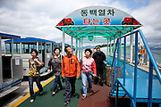 "People walking to Odongdo island in Yeosu which is connected to the shore by a 768-meter-long breakwater. Yeosu will host the Expo 2012 exhibition  under the theme ""The Living Ocean and Coast"". Yeosu (Yeosu-si) is a city in South Jeolla Province. Old Yeosu City, which was founded in 1949, Yeocheon City, founded in 1986, and Yeocheon County were merged into a new city in 1998."